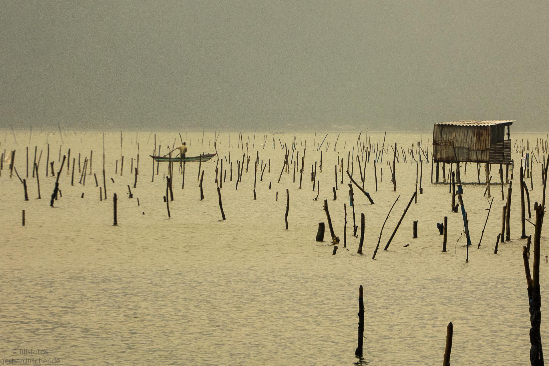 Fischer in Vietnam im Morgenlicht